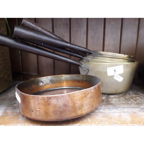 5 - 4 brass pans and a copper pan...