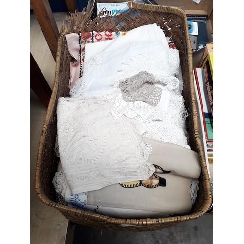 59 - A basket of vintage linen...