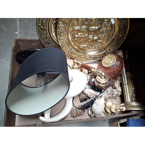 67 - A box of misc to include 2 large brass chargers, vintage style telephone, ornaments, lamp, etc...