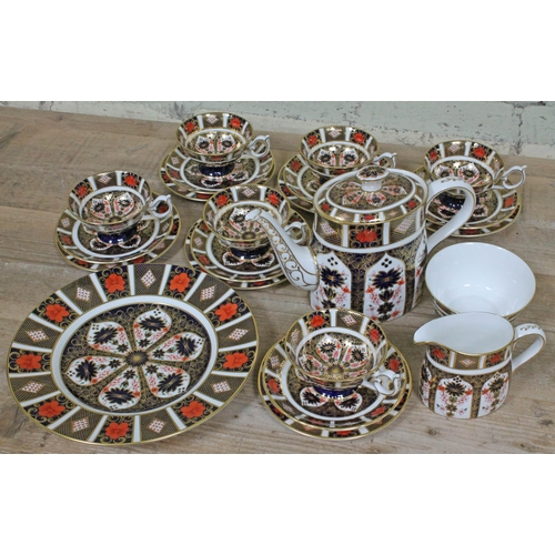 357 - A Royal Crown Derby 1128 pattern 22 piece porcelain tea set comprising six cups, saucers and side pl...