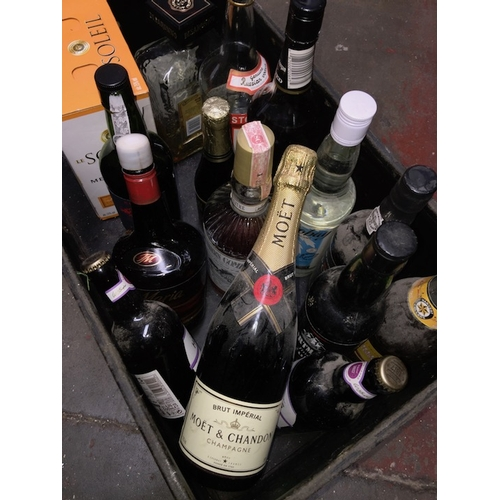 47 - A large box containing quantity of alcoholic beverages to include Moet & Chandon champagne, wine, po...