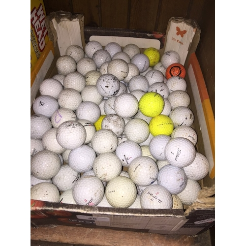 48 - A box of golf balls...