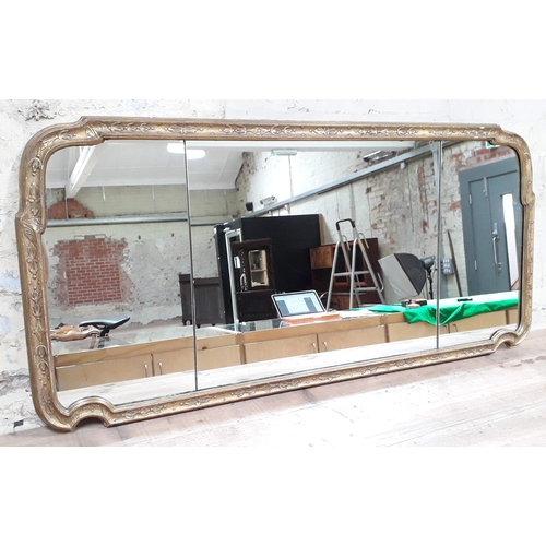 520 - A 19th century mirror, the glass split into three bevelled plates, gilt gesso and wood frame, 130cm ...