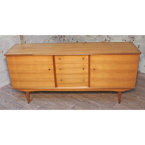 22 - An Alfred Cox Kenton sideboard for Heals, in French walnut with gilt brass knobs,