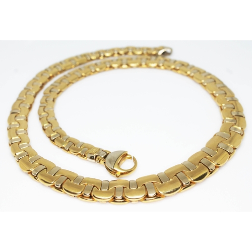105 - FRED JOAILLIER A vintage 18ct two colour gold flat link necklace circa 1970, marked 'FRED PARIS', al...