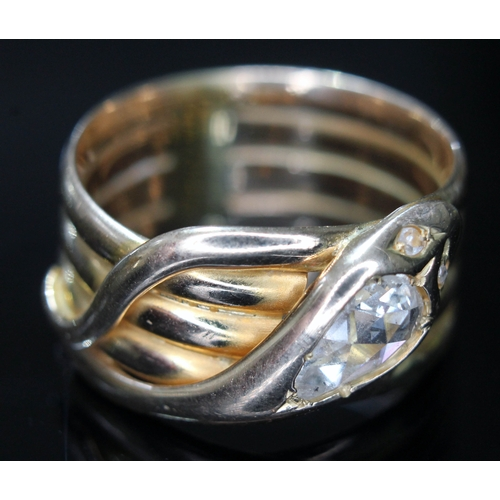 107 - A Victorian 18ct gold ring formed as a coiled snake, the head set with a rose cut pear shaped diamon...