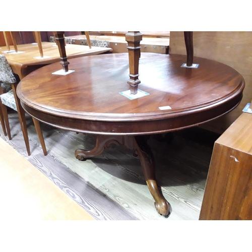 13 - A Victorian mahogany breakfast table....