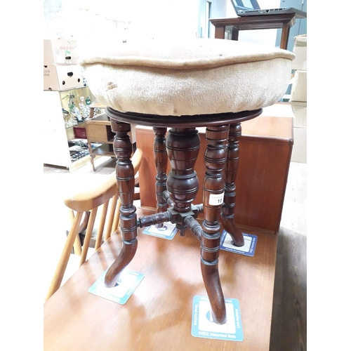 15 - A Victorian adjustable piano stool....