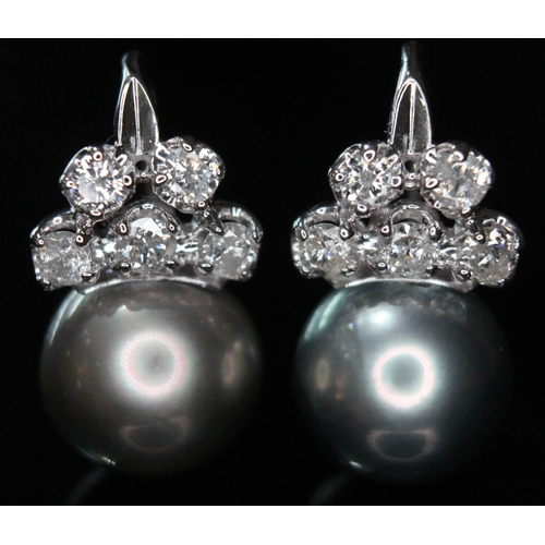 167 - A pair of pearl and diamond earrings, each featuring a black Tahitian pearl and five round brilliant...