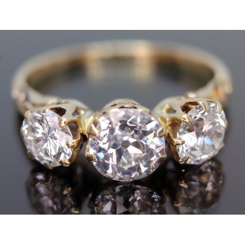 197 - A three stone diamond ring, the central stone approx. 1.02ct, the two stones either side approx. 0.6...