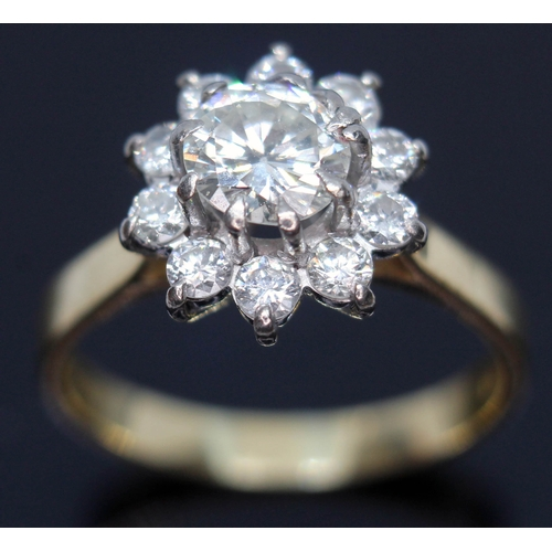 198 - A diamond cluster ring, the central stone approx. 0.90ct, surrounded by ten round brilliant cut diam...