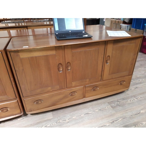 28 - An Ercol blonde elm sideboard....