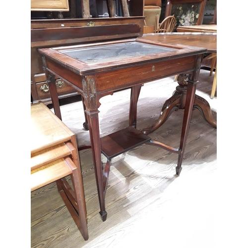 31 - An Edwardian display table, height 76cm....