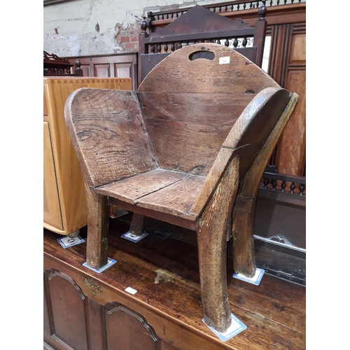 33 - A rustic wood chair, height 80cm....