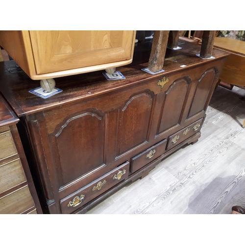 35 - An 18th century Lancashire oak mule chest, length 149cm....