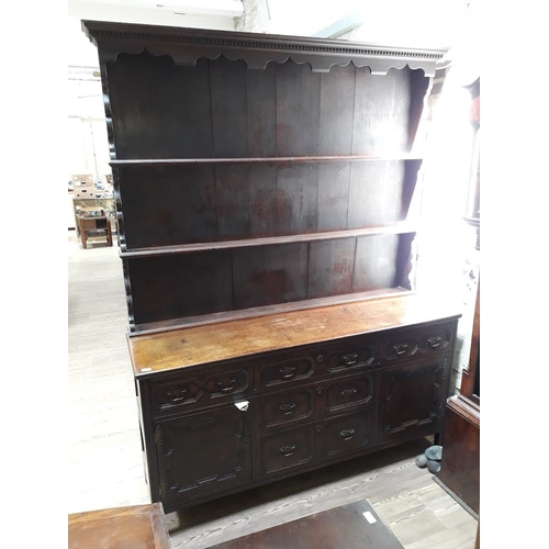 37 - An oak dresser circa 1900 with plate rack back, geometric drawer fronts and brass handles, width 175...