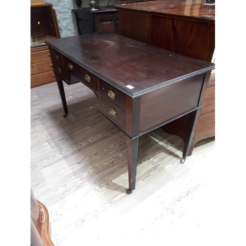 39 - A mahogany writing table with gilt brass handles, width 122cm, depth 60cm & height 77cm....