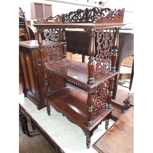 42 - A Victorian mahogany whatnot with pierced sides and turned supports, height 100cm....