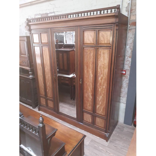 45 - A Victorian Aesthetic style ebonised and walnut bedroom suite comprising wardrobe, dressing table, m...