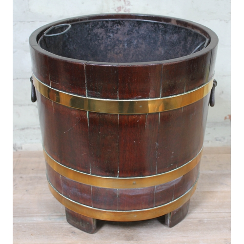 48 - A brass bound planter of barrel form, height 40cm....