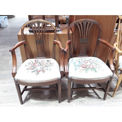 6 - A pair of George III and later mahogany armchairs with embroidered seats....