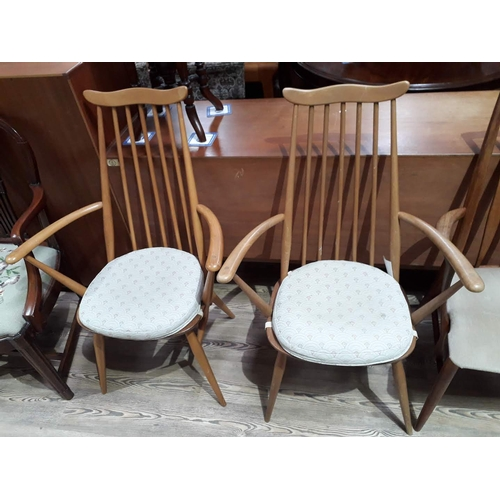 7 - A pair of Ercol blonde spindle back armchairs....