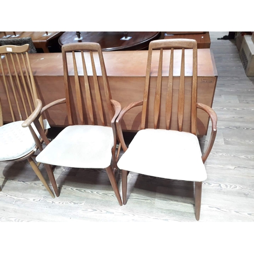 8 - A pair of Koefoeds Danish teak armchairs....