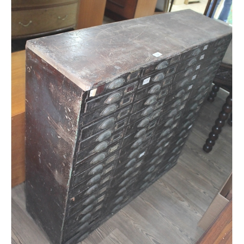54 - A 60 drawer cabinet containing approx 2000 watch glasses, width 104cm, depth 31cm & height 101cm....