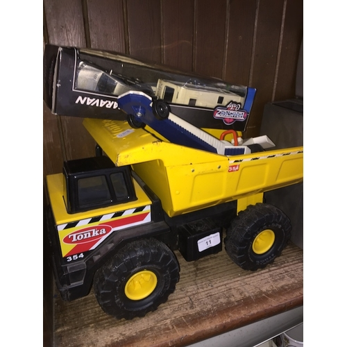 11 - A Tonka truck and a collection of other toys....