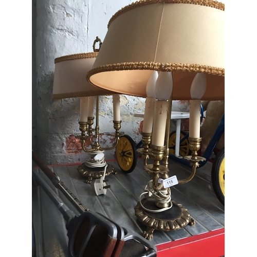 115 - A pair of brass lamps with shades...