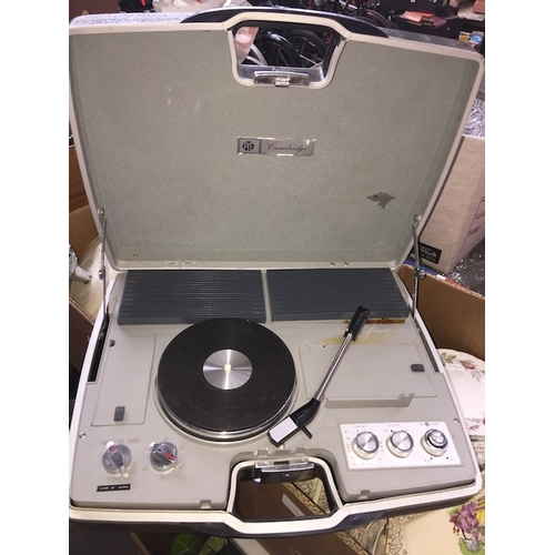 136 - A portable transistor stereo player and a wave band radio in briefcase....