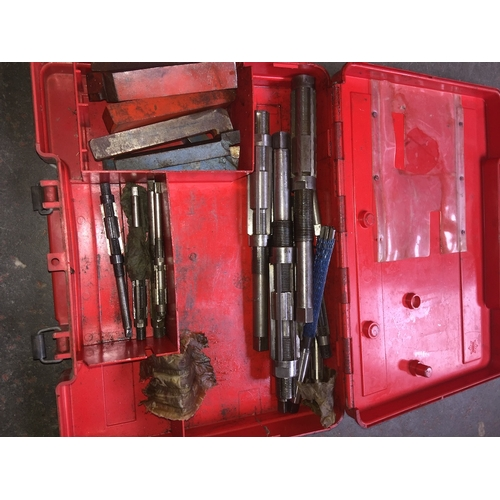 144 - A Hilti case with contents to include engineering tools, taps, drill lathe and grinder cutters, etc....