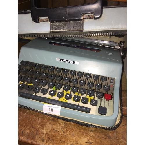 18 - A vintage Olivetti Lettera 32 typewriter in original case....