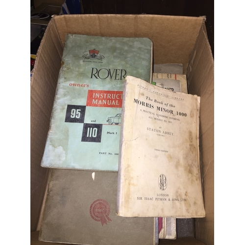 22 - A box of old car books....