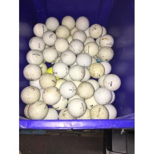 29 - A box of golf balls....