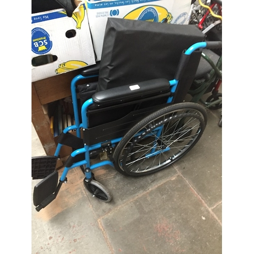54 - A folding wheelchair....