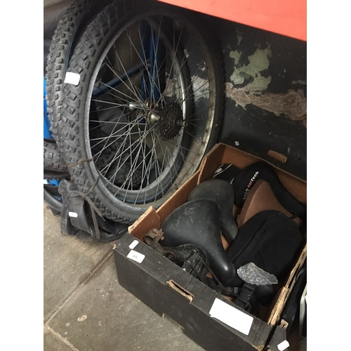 85 - A quantity of bicycle items, tyres, tubes and saddles...