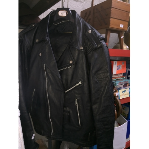 92 - A JTS motorcycle leather suit comprised of trousers and jacket....