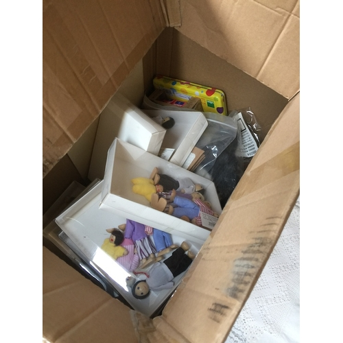 949 - A box of toys including dolls etc...