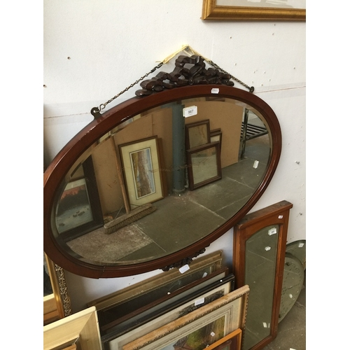 967 - Oval mahogany mirror with carving...
