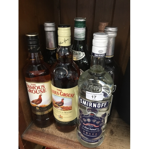 17 - A collection of alcoholic beverages to include a bottle of vodka Smirnoff 1L, 2 bottles of The Famou...