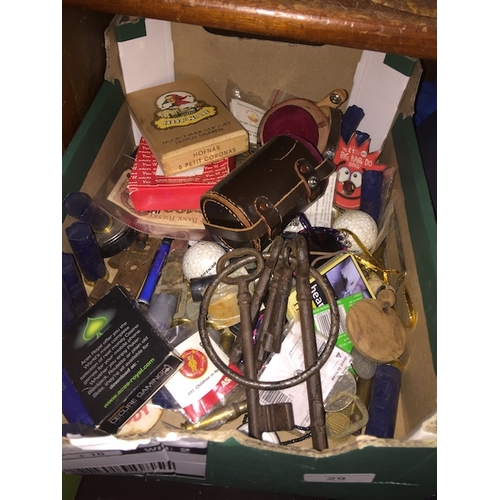 29 - A box of collectables including big jail keys, coins, etc....