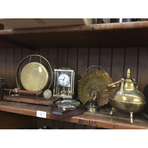 3 - A collection of brassware to include a gong, peacock, teapot, a barometer, a clock, etc....