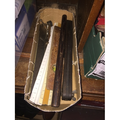 30 - A box of rulers - steel and wood and some deck gauges, etc...
