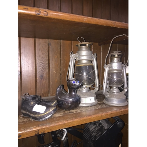 6 - A pair of paraffin lamps, a vintage silver plated money box in shape of a duck marked Falstaff and a...