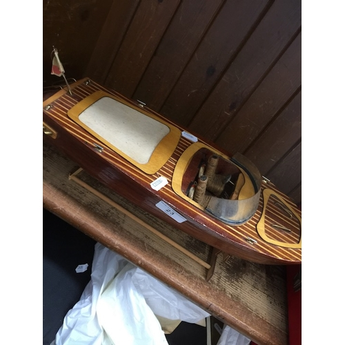 23 - A battery powered hand built wooden speedboat....