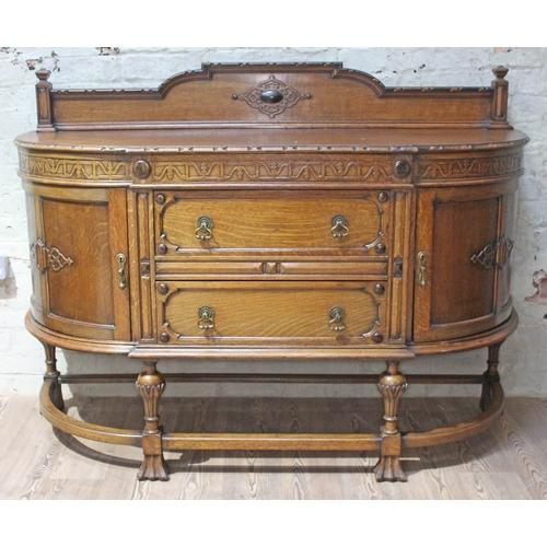 21 - A 1920s oak sideboard, length 153cm, depth 53cm & height 113cm....
