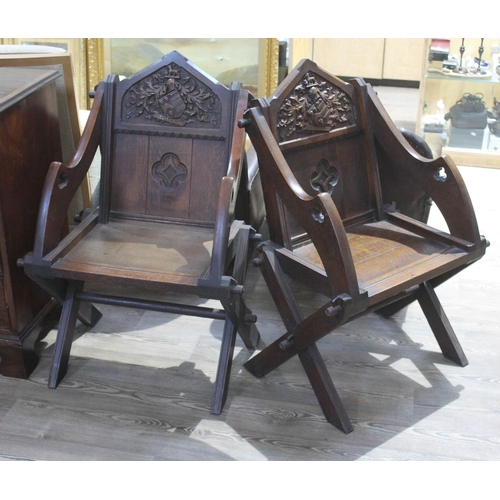 24 - A pair of early 20th century oak Glastonbury chairs....