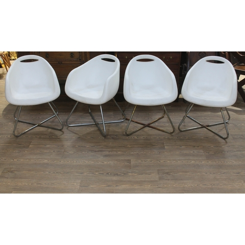 25 - A set of four Italian Casamania white plastic tub chairs with chrome legs....