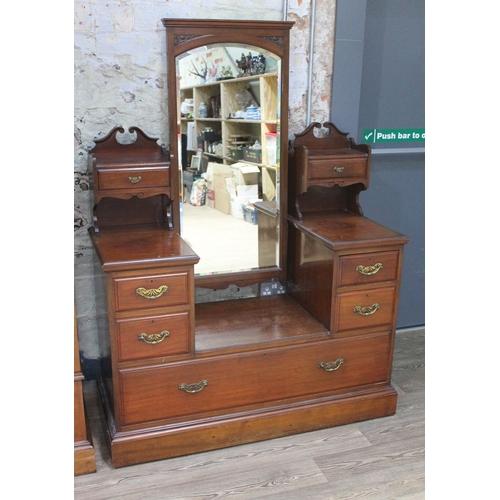 29 - A Victorian mahogany dressing table, width 131cm, depth 53cm & height 174cm....